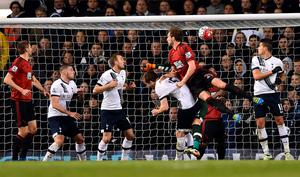 West Bromwich Albion's English defender Craig Dawson (3rd R) scores his team's first goal during the English Premier League football match between Tottenham Hotspur and West Bromwich Albion at White Hart Lane in London, on April 25, 2016. / AFP PHOTO / BEN STANSALL / RESTRICTED TO EDITORIAL USE. No use with unauthorized audio, video, data, fixture lists, club/league logos or 'live' services. Online in-match use limited to 75 images, no video emulation. No use in betting, games or single club/league/player publications.  / BEN STANSALL/AFP/Getty Images