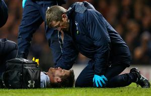 LONDON, ENGLAND - APRIL 25:  An injured Eric Dier of Tottenham Hotspur is given treatment during the Barclays Premier League match between Tottenham Hotspur and West Bromwich Albion at White Hart Lane on April 25, 2016 in London, England.  (Photo by Alex Morton/Getty Images)