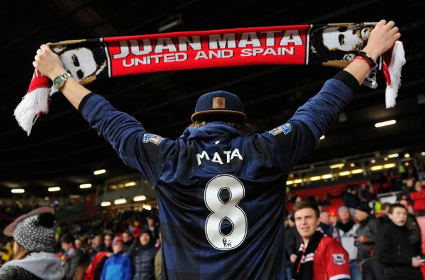 MANCHESTER, ENGLAND - JANUARY 28:  A Manchester United fan show his support for new signing Juan Mata prior to the Barclays Premier League match between Manchester United and Cardiff City at Old Trafford on January 28, 2014 in Manchester, England.  (Photo by Michael Regan/Getty Images)
