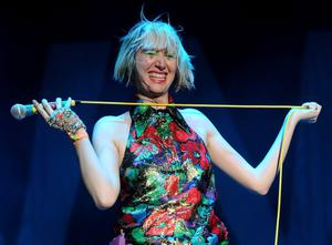 INDIO, CA - APRIL 12:  Singer Karen O of the band Yeah Yeah Yeahs performs onstage during day 1 of the 2013 Coachella Valley Music & Arts Festival at the Empire Polo Club on April 12, 2013 in Indio, California.  (Photo by Kevin Winter/Getty Images for Coachella)
