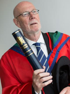 Dáithí O'Ceallaigh, former Irish Ambassador in London,  received the honorary degree of Doctor of Letters (DLitt) for his outstanding contribution to the Press Council of Ireland and the Peace Process. (Photo: Nigel McDowell/Ulster University)