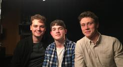 Young NI film critic Kasper Andreasen with Dean Charles Chapman (left) and George Mackay (right) the two stars of the Oscar and BAFTA nominated and Golden Globes winning war epic 1917.