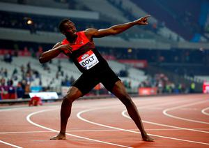 Simply the best: the great Usain Bolt with his trademark celebration after powering to victory in the 200m at the London Anniversary Games at the Olympic Stadium last night