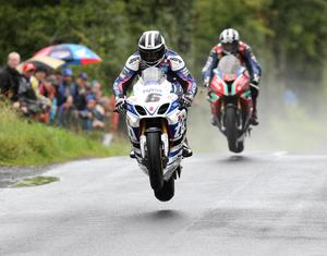 PACEMAKER, BELFAST, 2014: I have been privileged to photograph both generations of the Dunlop road racing family in action. In the 80s and 90s Joey and Robert did battle on the Irish roads and at the TT.  Over the last decade it has been Robert's sons, William and Michael, who have gone head to head in races like this at Armoy. The Armoy event began in 2009 and is run on the roads where Mervyn Robinson, Frank Kennedy, Joey and Jim Dunlop of the famous Armoy Armada would have tested their race bikes during unofficial practice sessions! PICTURE BY STEPHEN DAVISON