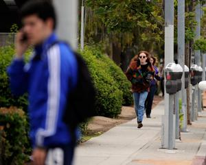 SANTA MONICA, CA - JUNE 07:  Students rush to safety after shots were fired near the Santa Monica College on June 7, 2013 in Santa Monica, California. According to reports, at least three people have been injured, and a suspect was taken into custody. (Photo by Kevork Djansezian/Getty Images)