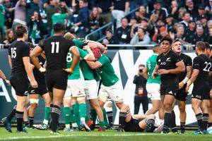 CHICAGO, IL - NOVEMBER 05:  Robbie Henshaw of Ireland is smothered by players after scoring a try during the international match between Ireland and New Zealand at Soldier Field on November 5, 2016 in Chicago, United States.  (Photo by Phil Walter/Getty Images)