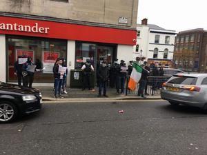 Saoradh target Santander In coordinated protests - Saoradh members based in Derry, Newry and Belfast carried out a series of co-ordinated protests in a day of direct action targeted at local branches of Santander today [October 17]. Pictured Santander, Butcher Street, Derry City