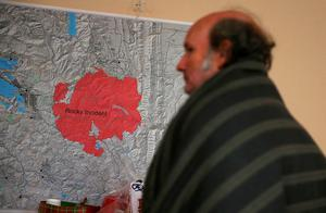 CLEARLAKE OAKES, CA - AUGUST 04:  Evacuated resident Daniel Myers looks at a map of the Rocky Fire at the Moose Lodge where several dozen evacuees are staying on August 4, 2015 in Clearlake Oakes, California. Nearly 3,000 firefighters are battling the Rocky Fire that has burned 65,000 acres and has forced the evacuation of 12,000 residents in Lake County. The fire is currently 12 percent contained and has destroyed at least 14 homes. 6,300 homes are threatened by the fast moving blaze.  (Photo by Justin Sullivan/Getty Images)