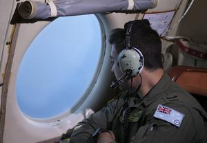 SOUTHERN INDIAN OCEAN - MARCH 22:  Sargent Matthew Falanga on board a Royal Australian Air Force AP-3C Orion, scans for debris or wreckage of missing Malaysian Airlines flight MH370 on March 22, 2014 in Southern Indian Ocean, off the west coast of Australia (Photo by Rob Griffith-Pool/Getty Images)