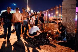 People tend to the wounded outside the festival ground after an apparent shooting on October 1, 2017 in Las Vegas, Nevada.  There are reports of an active shooter around the Mandalay Bay Resort and Casino.  (Photo by David Becker/Getty Images)