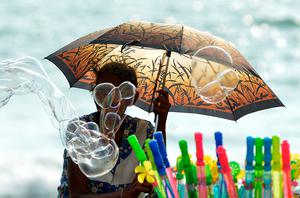 A Sri Lankan vendor sells bubble liquid on the Galle Face promenade in the heart of the Sri Lankan capital of Colombo on April 19, 2015.   AFP/Getty Images