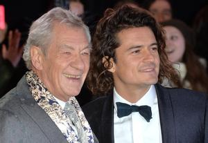 """Sir Ian McKellen(L) and Orlando Bloom attend the World Premiere of """"The Hobbit: The Battle OF The Five Armies"""" at Odeon Leicester Square on December 1, 2014 in London, England.  (Photo by Anthony Harvey/Getty Images)"""