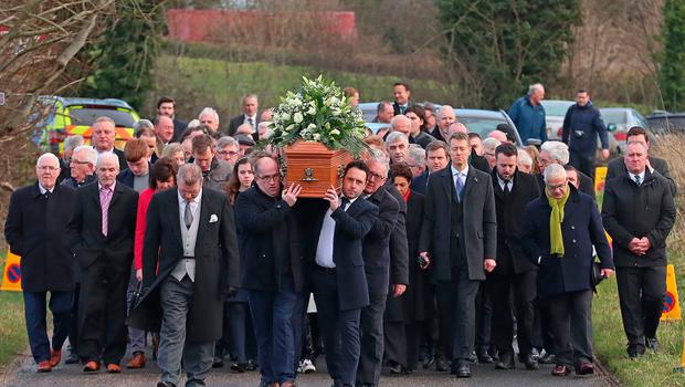 The coffin of Seamus Mallon is carried to Saint James of Jerusalem Church in Mullaghbrack, Co Armagh. Pic: Liam McBurney/PA Wire