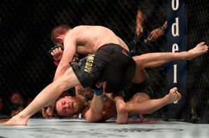 LAS VEGAS, NV - OCTOBER 06:  Khabib Nurmagomedov of Russia (top) punches Conor McGregor of Ireland in their UFC lightweight championship bout during the UFC 229 event inside T-Mobile Arena on October 6, 2018 in Las Vegas, Nevada.  (Photo by Harry How/Getty Images)