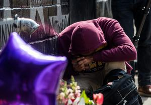 MINNEAPOLIS, MN - APRIL 21: A young man cries at the memorial for Prince outside First Avenue nightclub on April 21, 2016 in Minneapolis, Minnesota. Prince died earlier today at his Paisley Park compound at the age of 57. (Photo by Stephen Maturen/Getty Images)