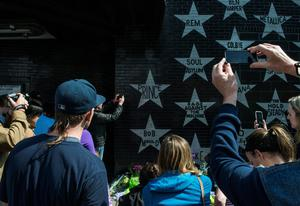 MINNEAPOLIS, MN - APRIL 21: Fans and onlookers pay their respects to Prince outside First Avenue nightclub on April 21, 2016 in Minneapolis, Minnesota. Prince died earlier today at his Paisley Park compound at the age of 57. (Photo by Stephen Maturen/Getty Images)