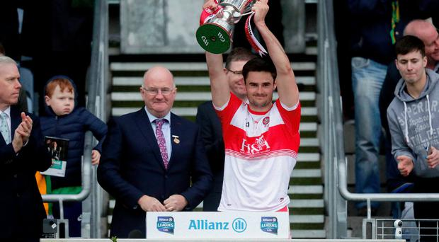 Silver lining: Derry captain Christopher McKaigue lifts the Division Four trophy