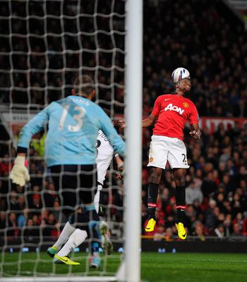 Manchester United's Wilfried Zaha jumps for the ball during the Capital One Cup, Fourth Round match at Old Trafford, Manchester.
