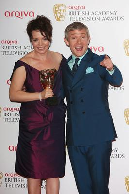 LONDON, ENGLAND - MAY 12: Olivia Colman with her Best Supporting Actress Award and Martin Freeman during the Arqiva British Academy Television Awards 2013 at the Royal Festival Hall on May 12, 2013 in London, England.  (Photo by Tim P. Whitby/Getty Images)