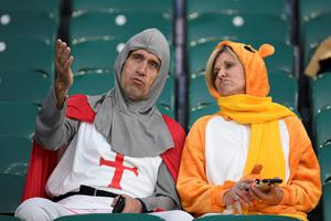 Rugby fans sit prior to  a Pool A match of the 2015 Rugby World Cup between England and Australia at Twickenham stadium, south west London, on October 3, 2015.  AFP PHOTO / MARTIN BUREAU  RESTRICTED TO EDITORIAL USE, NO USE IN LIVE MATCH TRACKING SERVICES, TO BE USED AS NON-SEQUENTIAL STILLSMARTIN BUREAU/AFP/Getty Images
