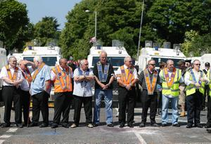 Press Eye - Belfast -  Saturday 20th July 2013   Orange Marshalls pictured on the Woodvale Road in Belfast afternoon attempt to parade up to the police lines.  In an unexpected move earlier this week, Orangemen made a new application to the Parades Commission adjudication body to march the disputed Crumlin Road section of the route today. That bid was again rejected by the commission - a move that is likely to prompt another stand-off between police and protesters at the same community interface area later.  The Order said it applied for Saturday's event to complete a return parade they were banned from making on the Twelfth of July.  Order members have continued to hold protests in the area throughout the week.  Picture by Kelvin Boyes / Press Eye.