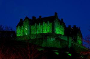 Edinburgh Castle in Scotland illuminated green as it is among more than 100 international landmarks turning green to mark St Patrick's Day.