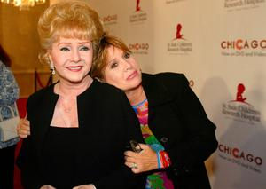 """FILE - In this Tuesday, Aug. 19, 2003 file photo, Debbie Reynolds and Carrie Fisher arrive at the """"Runway for Life"""" Celebrity Fashion Show Benefitting St. Jude's Children's Research Hospital and celebrating the DVD release of Chicago in Beverly Hills, Calif. On Tuesday, Dec. 27, 2016, a publicist said Fisher has died at the age of 60. (AP Photo/Jill Connelly, File)"""