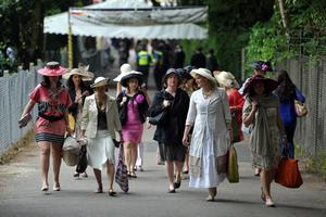 Racegoers arrive on the train for day three of the Royal Ascot meeting at Ascot Racecourse, Berkshire. PRESS ASSOCIATION Photo. Picture date: Thursday June 20, 2013. See PA story RACING Ascot. Photo credit should read: Tim Ireland/PA Wire