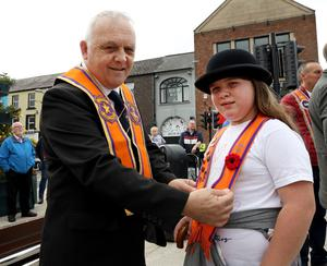 PACEMAKER PRESS BELFAST  13/7/2020 Twelfth of July celebrations in Portadown today. People were encouraged to celebrate the Twelfth from home due to coronavirus. The Orange Order were not parading today, however, a small number of local lodges took part in a Remembrance Service at Portadown Cenotaph.  Pictured George and Kaitlynn Laverty. Photo Pacemaker Press