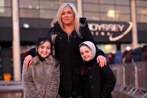 13.03.13. PICTURE BY DAVID FITZGERALD Girls Aloud Fans outside the Odyssey Arena, Belfast yesterday before the concert. Gail Martin with her daughters, Kerry (9) and Holly (8)