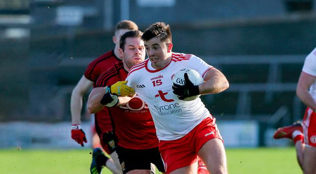 In control: Ronan O'Neill of Tyrone gets away from Down ace Gerard Collins