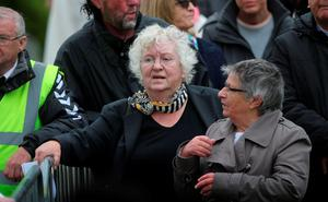 Civil rights campaigner Nell McCafferty (left) attends the funeral of Dr Edward Daly at St Eugene's Cathedral in Londonderry. PRESS ASSOCIATION Photo. Picture date: Thursday August 11, 2016. The former Bishop of Derry who came to the aid of a dying civil rights protester on Bloody Sunday and waved a white handkerchief in an enduring image of the Troubles died on Monday aged 82. See PA story ULSTER Daly. Photo credit should read: Niall Carson/PA Wire