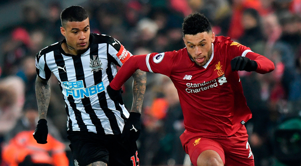 On the ball: Liverpool's Alex Oxlade-Chamberlain (right), who has invested in STATSports, takes on Robert Kenedy of Newcastle United