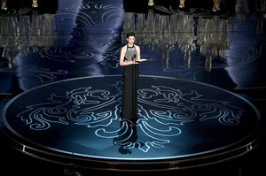 HOLLYWOOD, CA - MARCH 02:  Actress Anne Hathaway speaks onstage during the Oscars at the Dolby Theatre on March 2, 2014 in Hollywood, California.  (Photo by Kevin Winter/Getty Images)