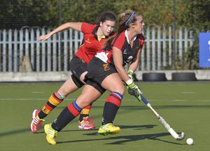Battle: Clodagh Maloney of UCC eludes Lurgan's Kerrie Burns