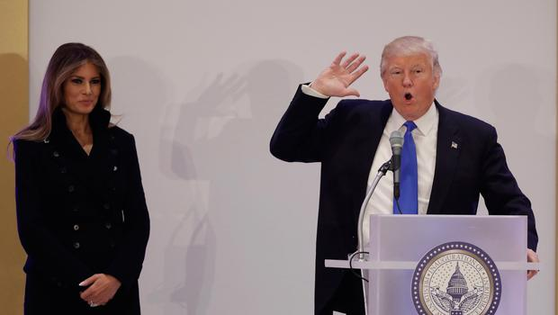 President-elect Donald Trump, accompanied by his wife Melania, speaks at the Leadership Luncheon, Thursday, Jan. 19, 2017, in Washington. (AP Photo/Evan Vucci)