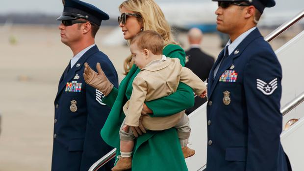 Ivanka Trump carries her son Theodore Kushner, as they arrive at Andrews Air Force Base, Md., Thursday, Jan. 19, 2017, for her father's inauguration. (AP Photo/Evan Vucci)