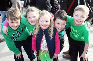 The Belfast parade departed from city hall at noon and is making its way to Custom House Square for a free concert. Charlie Bradley (9), Courtney Dempsey (8), Nellie-Rose Bradley (4), Stephen Dempsey (9) and Ruairi Bradley (7).