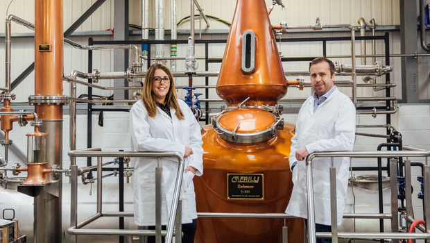 Fiona and David Boyd-Armstrong at one of the new copper stills that have been installed at Rademon Estate Distillery in Crossgar