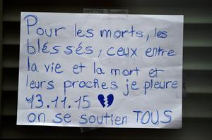 PARIS, FRANCE - NOVEMBER 16:  Messages are left on the window of La Belle Equipe cafeon Rue de Charonne following Friday's terrorist attack on November 16, 2015 in Paris, France. France, currently observing three days of national mourning, will fall silent for one minute at 12pm local time today in an expression of solidarity with the victims of the terrorist attacks, which left at least 129 people dead and hundreds more injured.  (Photo by Jeff J Mitchell/Getty Images)