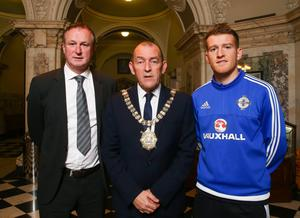 Belfast Lord Mayor Arder Carson pictured with Northern Ireland manager Michael O'Neill and captain Steven Davis at a civic reception in City Hall hosted by Belfast City Council to congratulate the squad on its success in reaching the finals of the European Championship.  Photo by William Cherry/Press Eye