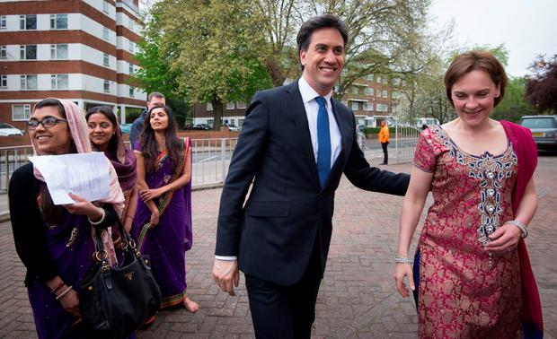 Labour leader Ed Miliband and his wife Justine (right) meet Hindu devotees at the Shree Swaminarayan Temple in Willesden Green, London, where they attended a celebration ceremony. Stefan Rousseau/PA Wire