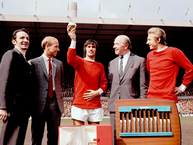 Best man: George Best (c) shows off the 1968 European Footballer of the Year award, which journalist Max Urbini (l) presented to him before the match, as team-mates Bobby Charlton (second l, 1966 winner) and Denis Law (r, 1964 winner), and manager Matt Busby (second r) look on