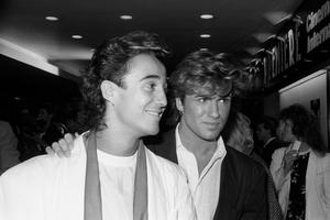Wham's Andrew Ridgeley and George Michael (right). Pop superstar Mr Michael has died peacefully at home, his publicist said. 08/10/84