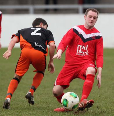 Action from the Irish Cup 6th round between Ballyclare Comrades FC and Carrick Rangers FC