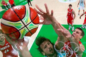 An overview shows Argentina's centre Marcos Delia (L) and Croatia's centre Darko Planinic go for a rebound during a Men's round Group B basketball match between Argentina and Croatia at the Carioca Arena 1 in Rio de Janeiro on August 9, 2016 during the Rio 2016 Olympic Games. / AFP PHOTO / POOL / STRINGERSTRINGER/AFP/Getty Images