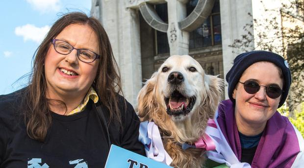 Pictured at Buoy Park, Belfast, to announce the Trans Pride NI 2019 Festival are representatives of Trans Pride NI, from left, Adrianne Elson, Ozzy the Golden Retriever and Michael Steven. Photography: Bout Yeh