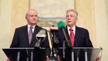 First Minister Peter Robinson and Deputy First Minister Martin McGuinness sign the copy of the document 'A Fresh Start - The Stormont Agreement and Implementation Plan' pictured at Stormont Castle. Picture by Kelvin Boyes / Press Eye