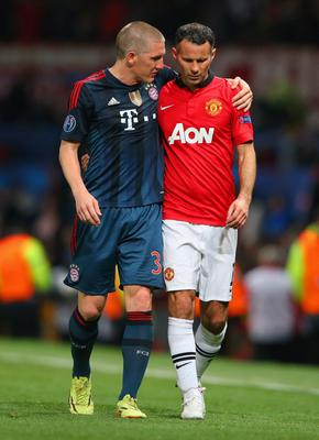 MANCHESTER, ENGLAND - APRIL 01:  Bastian Schweinsteiger of Bayern Muenchen and Ryan Giggs of Manchester United walk in at half time during the UEFA Champions League Quarter Final first leg match between Manchester United and FC Bayern Muenchen at Old Trafford on April 1, 2014 in Manchester, England.  (Photo by Alex Livesey/Getty Images)