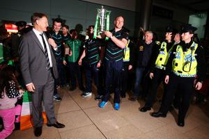Ireland captain Paul O'Connell lifts the trophy while head coach Joe Schmidt (left) looks on as the Ireland team arrive at Dublin Airport, Ireland. Pic Brian Lawless